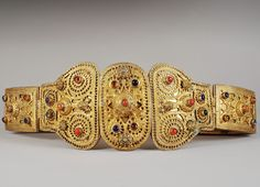 Armenian liturgical priest's belt. From Central or eastern Anatolia, 19th century.  Gilt silver; consisting of two rectangular plates decorated with semi-precious stones. The loop consists of 3 elements, also decorated with precious stones. (Armenian Museum of France, Paris)