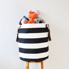 Large black and white striped laundry hamper. Great round storage basket with leather straps will make a great storage basket for any space.  It'll be great in your kids room, bathroom, craft room or nursery! 0 handmade fabric basket is really great to get organized & stay neat.   * Toy storage * Laundry hamper * Bathroom  * Nursery * Beddings & blankets * Crafting supplies   The outside is a heavy weight cotton canvas fabric, inside cotton fabric.