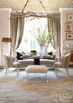 Pink is just fabulous any way it comes, but blush just may be our favorite right now. Subtle and warm blush paint makes this living room a winner. Designed by Amy Morris Interiors