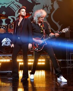 Snapshot: June 17 - Adam Lambert And Brian May - Oh, mama mia! Adam Lambert and Queen's Brian May are too fierce during a performance at the iHeartRadio Theater on June 16 in Burbank, Calif.