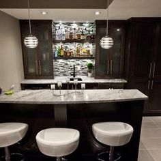 Basement bar - nice contrast between grey marble & barstools and dark wood. Like simple shelves between two cupboards. Also like real but casual bar structure; not arrogant like other home bars. Basement House, Basement Kitchen, Basement Plans, Basement Ideas, Basement Colors, Basement Layout, Basement Bathroom, Kitchen Decor, Cheap Basement Remodel