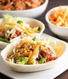 Chicken Taco Boats. Shredded chicken and tortilla boats make for a simple slow-cooker dinner!