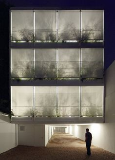 Buenos Aires office/apt. project with recessed balconies filled with plants for shading the interior   Once Building by Adamo-Faiden