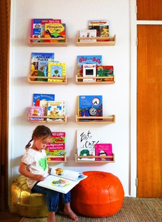 Spice rack bookshelf. $2 spice rack from Ikea, turned into a bookshelf for kids. Maybe a bedside bookshelf for adults, too!