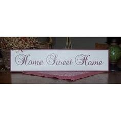 """Home Sweet Home by CreateYourWoodSign.com  Hand painted wood sign The size is 19"""" by 4.5"""" The background is beige with barn red lettering The font is baroque script"""
