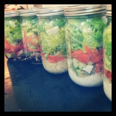 salad jars. start with salad dressing on the bottom, then veggies & meat, then lettuce last. seal with food saver and it will stay good for a week.