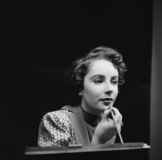 Touching up her lipstick in November of 1948.   - ELLE.com