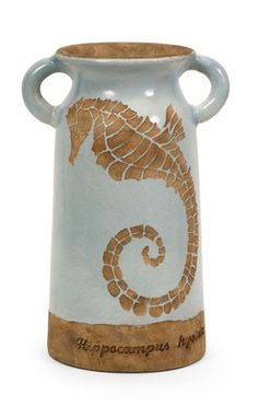 Naples Tall Urn with Seahorse Fired red clay finished in a light blue glaze. Special reverse painting technique reveals a seahorse shape. Excellent coastal accent piece that will add timeless beauty t