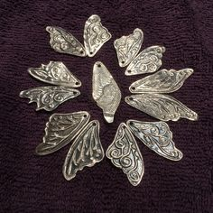 Working all day on sterling silver Faerie wings, center is the back which is imprinted with Chantilly lace. Finished tomorrow with wee gemstones and ear wires as I am resting  my weary bones tonight.
