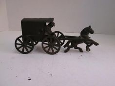"ANTIQUE CAST IRON HORSE DRAWN CARRIAGE WITH REMOVABLE MAN & woman Estimated Price: $79 Description: ANTIQUE CAST IRON HORSE DRAWN CARRIAGE WITH REMOVABLE MAN & WOMAN - CHILDREN IN REAR WAGON - MEASURES 8.5"" X 2.75"" X 4"" - APPROXIMATE WEIGHT 4 LBS"