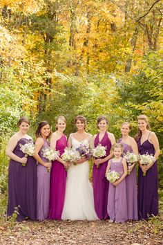 Purple mismatched bridesmaids dresses/ Amber Green Photography