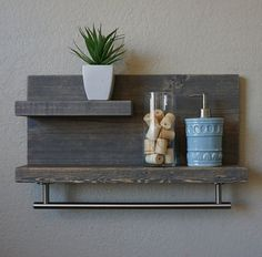Handmade bathroom shelf with an 18 satin nickel towel bar. A perfect addition to any home bathroom or apartment.  Made of real solid wood. It has been lightly sanded down, then stained and sealed with a beautiful weathered gray finish.  This piece does not include the accessory items as shown in the pictures.  The color of the stained wood captured in the photos might vary slightly.  Dimensions: 23 in wide x 11.25 in tall x 4/6 in deep (top shelf 3.5 in deep x 12 in long, lower shelf 3.5/5.5…