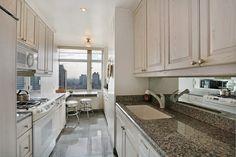 mirror backsplash  and grey floor tiles