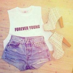Forever young muscle top with light wash shorts and lace platfrom booties .