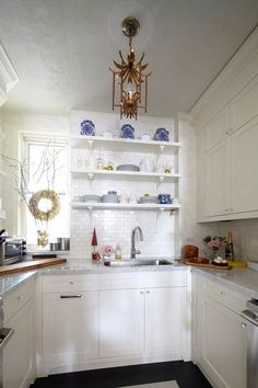 Kitchen inspiration - blue with white is great and so is that light fixture.