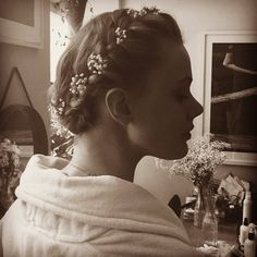 Frida Gustavsson wore her hair in a braided crown, with Baby's Breath flowers