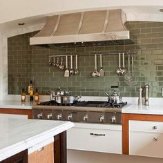 Deep-green tile provides subtle color to this modern kitchen. More kitchen backsplash ideas: http://www.bhg.com/kitchen/backsplash/kitchen-backsplash-ideas/#page=19