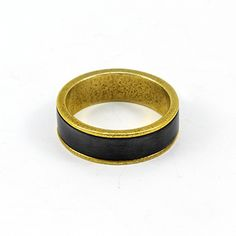 Custom made wedding band by Julie Bégin. 22k gold and sterling silver.