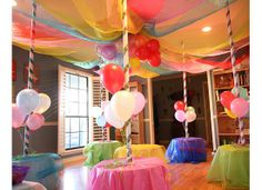 Carousel Theme Party ~ small tables, PVC pipe wrapped with ribbon and colors of sparkle mesh draped to make the room look like a carousel... this is so adorable and creative!