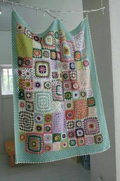 Love all the different granny squares in thei blanket.