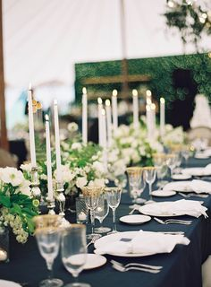 Navy blue table linens with white and green flowers.