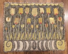 One of my favorite rugs I have hooked - love the yellows and gray wools I purchased from janice johnson. sunshine tulips pattern by wooley fox @animblethimble Now I need to find it a home ❤️ #reillyrugs
