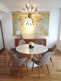 mid-century dining room- map on wall, low buffet and cool chandelier