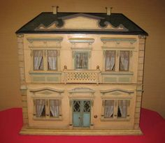 This Christian Hacker antique doll house comes complete with a clockwork elevator that is hidden behind two doors in the house.