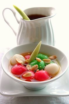 wedang ronde - Indonesian traditional ginger and palm sugar drink served in a bowl , mixed by sticky rice balls with peanut inside