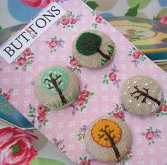 Embroidered buttons~ love it.  **** I would cover rocks, decorate and use to hold patterns down while cutting them out. vhb 6/27/'14
