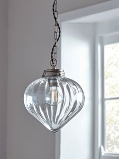 Beautifully crafted from glass with an etched brass top, brass chain and matching ceiling rose, our feminine pendant light has a fluted droplet shape to reflect the light and cast pretty patterns across your living space. Feature in any room o Geometric Pendant Light, Glass Pendant Light, Ceiling Pendant, Glass Pendants, Pendant Lighting, Ceiling Lights, Glass Ceiling, Kitchen Pendants, Round Pendant