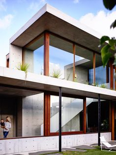 created as a walled sanctuary, thick concrete walls juxtaposed with shuttered panels form the property's exterior.