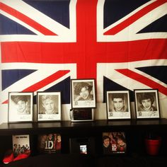 My British/One Direction inspired room :) British flag, individual autographed pictures of each member of 1D, hard copies of both of 1D's books, red Toms, and the yearbook edition of Up All Night!