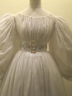 """Early 1830s tamboured muslin dress with full sleeves. """"Fashion Forward"""" exhibit, Musee de Arts Decoratifs. Photo by Charity Calvin Armstead via Facebook."""