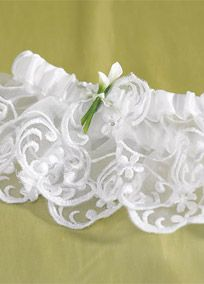 Add the finishing touch to your wedding outfit with our Bridal Beauty Calla Lily Bridal Garter. With its sheer embroidered design and wonderfully handcrafted porcelain Calla Lily, this garter is accented with a delicate white ribbon.