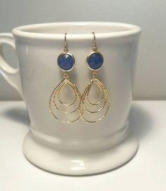 Check out this item in my Etsy shop https://www.etsy.com/listing/223662135/dark-blue-and-matte-gold-drop-earrings