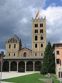 The Monastery of Santa Maria de Ripoll is a Benedictine monastery, built in the Romanesque style, located in the town of Ripoll in Catalonia, Spain. Although much of the present church is 19th century rebuilding, the sculptured portico is a renowned work of Romanesque art.