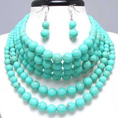 "CHUNKY TURQUOISE BLUE FAUX PEARL THEME SILVER TONE NECKLACE SET    * If you need a necklace extender I have them for sale in my store.*                NECKLACE: 14 1/2"" + 3"" EXT    DROP: 2 1/2"" LONG    EARRING: 2"" LONG               COLOR: SILVER TONE  $23.99"