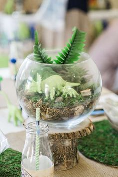 Centerpieces at a dinosaur birthday party! See more party planning ideas at CatchMyParty.com!