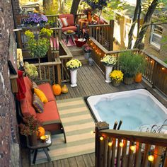 Love this small patio setup with the built-in hot tub! The string lights and yard décor make it a great space to entertain or simply relax.