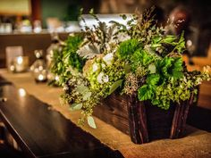 Rustic green wedding centerpiece in a wooden crate. L. Marie Events, New York.