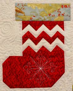 detail, Deckade the Halls, 2014 raffle quilt, Westside Quilters Guild (Oregon). Made by Marcia Elliott, pattern by Fat Quarter Shop, quilted by Marci Yoder.