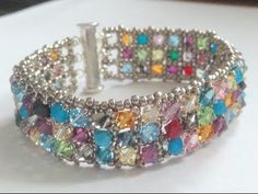 New Youtube tutorial for right angle weave cuff. Make the bracelet yourself or you can purchase the bracelet at: http://www.artfire.com/ext/shop/product_view/JRPDesigns/10103605/fall_cuff_bracelet--multicolored/handmade/jewelry/bracelets/beadwork
