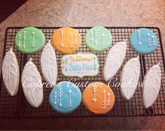 Custom tribal theme feather and arrow cookies for a baby shower. Decorated with royal icing.