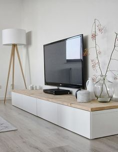 Easily done - you could use Ikea Besta units topped with a timber top or kitchen bench top