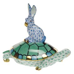 Herend Tortoise w/hare on back hand painted porcelain figurine.  Hare blue fishnet, tortoise green, w/ green blue black shell, and some gold accents.