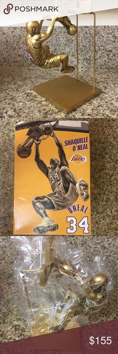 NIB Shaquille O'Neal Statue Shaquille O'Neal received the greatest honor that the franchise has to offer.  The three-time NBA Finals MVP was on hand for the unveiling of a bronze statue of him dunking off the side of Staples Center. I bought this at the unveiling and have kept it in it's original box.  Shaq — who is only the fifth Laker to ever earn the distinction — was surrounded by teammates and legends like Kobe Bryant, Kareem Abdul-Jabbar and Jerry West, while fans flocked to catch a…