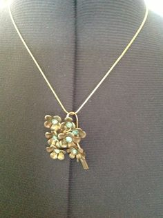 """Vintage pin pendant on 16"""" sterling silver chain. $25."""