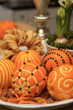 Aromatic Citrus and Clove Ornaments: Poke whole cloves into oranges, lemons and limes, covering the whole fruit or creating a pattern. Place in clear bowls.