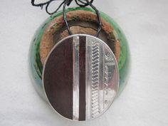 tuareg pendant. silver with asskrem acacia.